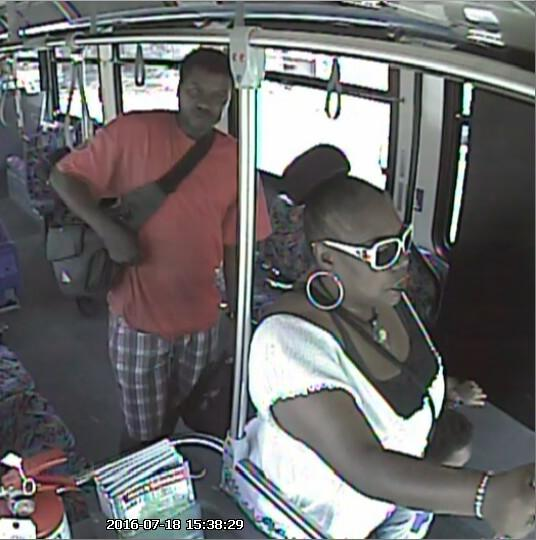 Suspects of MTD wallet theft pictured exiting bus. Photo submitted by Crime Stoppers.