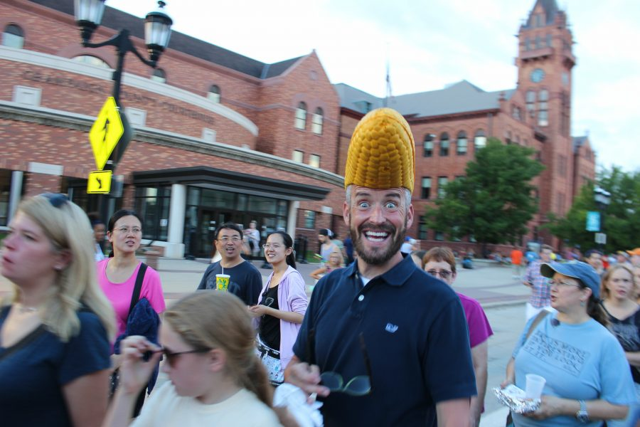 A festivalgoer shows off his headwear at the Urbana Sweetcorn Festival in downtown Urbana on Saturday.