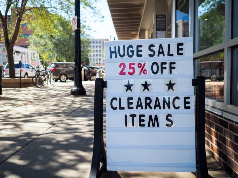 T.I.S. - former bookstore - is now The Illini Shop and unabashedly advertises their current sale in Champaign, IL. August 22, 2016.