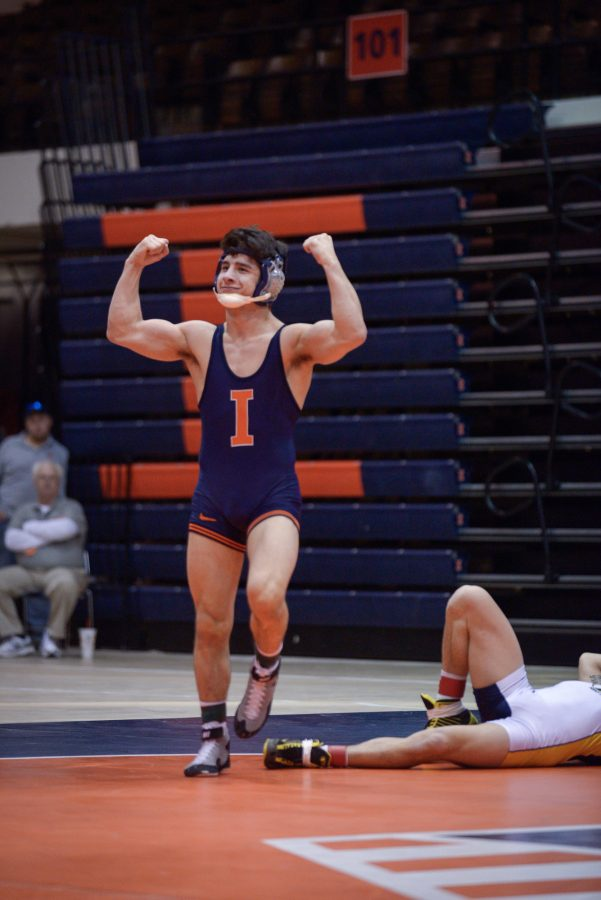 Illinois%27+Isaiah+Martinez+pops+off+after+his+victory+over+Kent+State%27s+Ian+Miller+during+the+match+at+Huff+Hall+on+Sunday%2C+February+15%2C+2015.The+Illini+won+38-0.