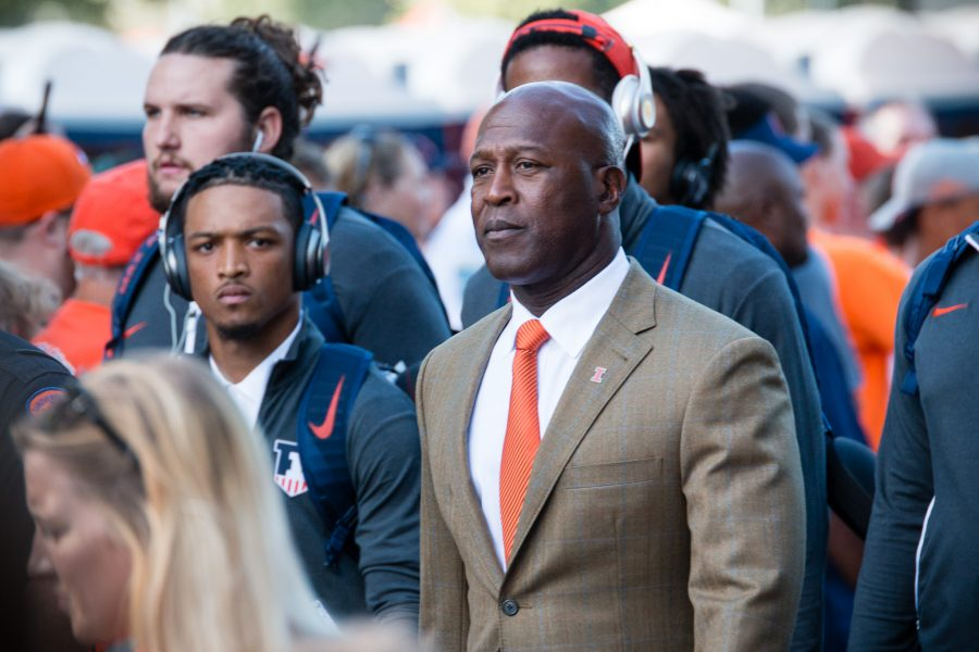 Illinois+head+coach+Lovie+Smith+walks+down+First+Street+before+the+game+against+North+Carolina+at+Memorial+Stadium+on+Sept.+10%2C+2016.