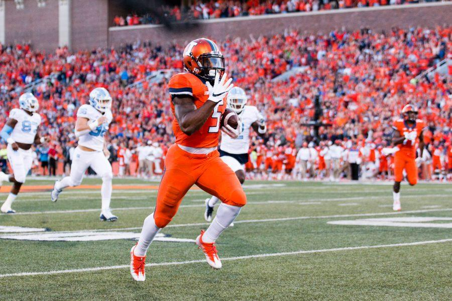 Illinois running back Ke'Shawn Vaughn (5) runs down the sideline for the first touchdown of the game against North Carolina at Memorial Stadium on Saturday, September 10. The Illini loss 48-23.