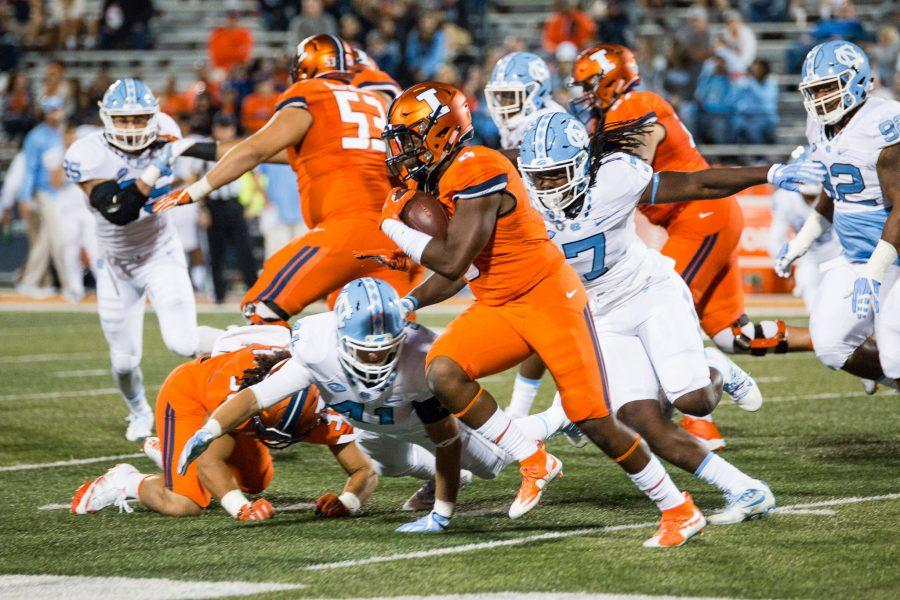 Illinois running back Tre Nation (6) rushes by some North Carolina linebackers during the game against North Carolina at Memorial Stadium on Saturday. The Illini lost 48-23.