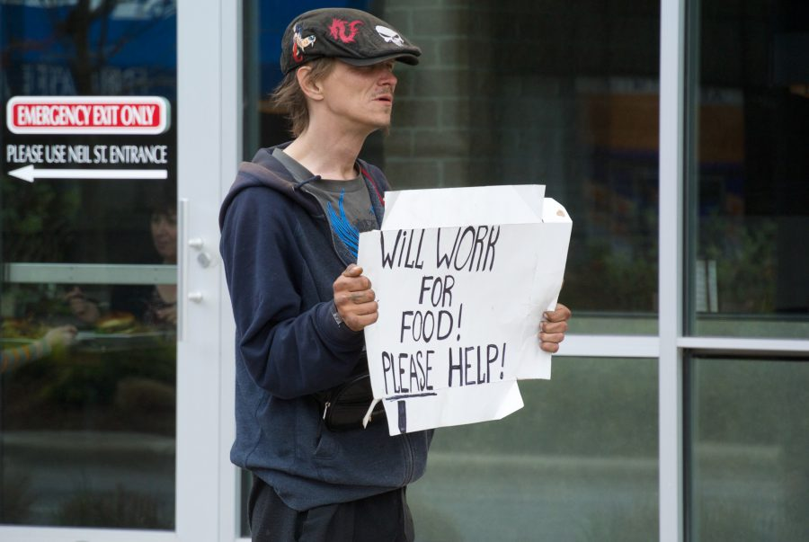 Panhandler+%22Ghost%22+flies+a+sign+in+Downtown+Champaign+on+Wednesday%2C+April+29%2C+2015.