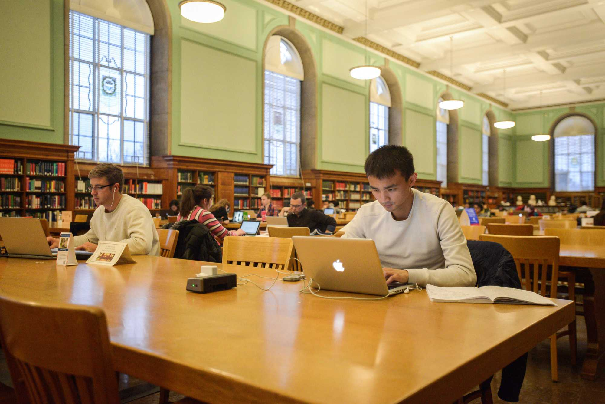 Huijing Cai, graduate in Business, studies in the Main Library on Sunday, February 15, 2015.