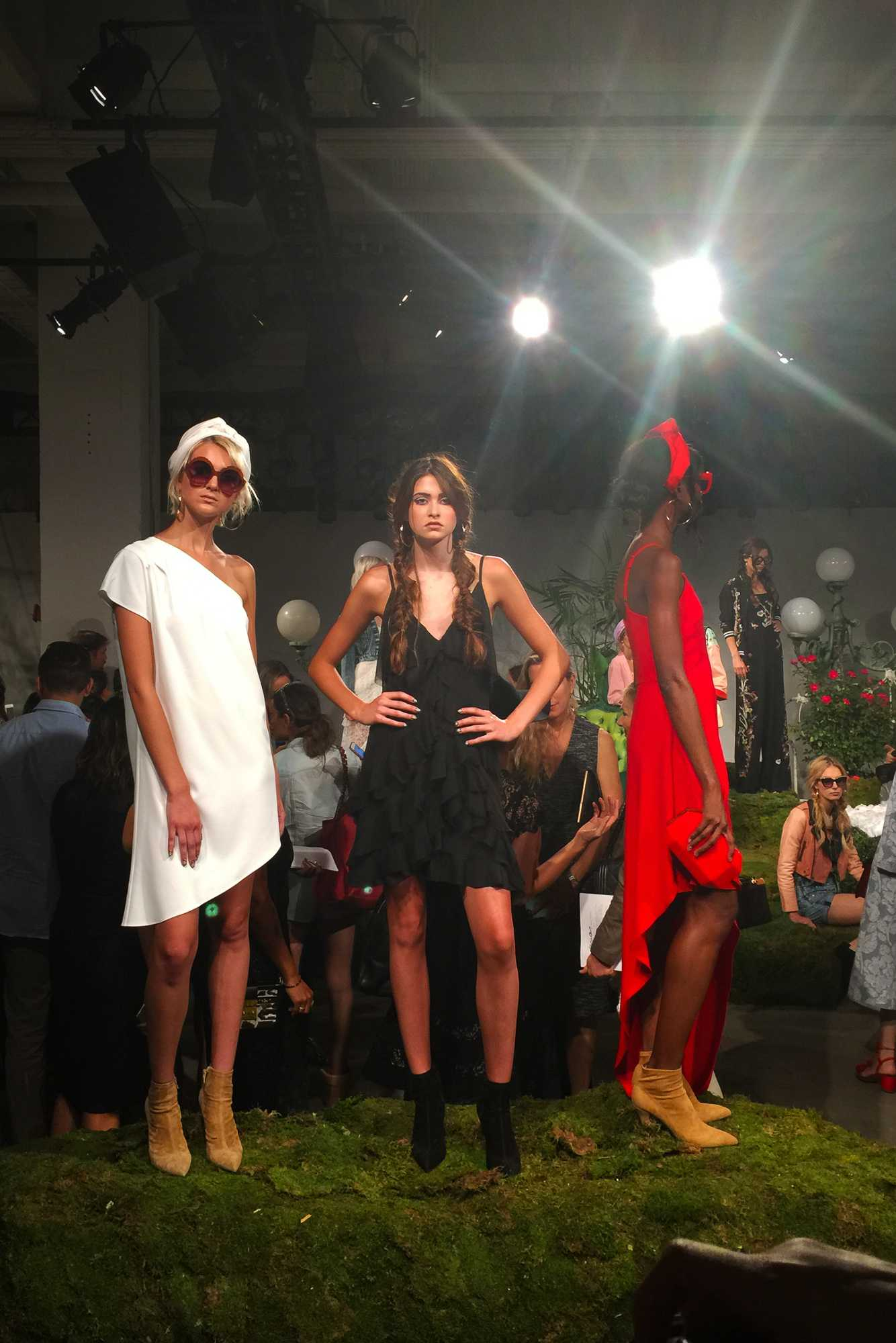 Models stand in designer clothing for the AO Spring 2017 Presentation during 2016 New York Fashion Week.