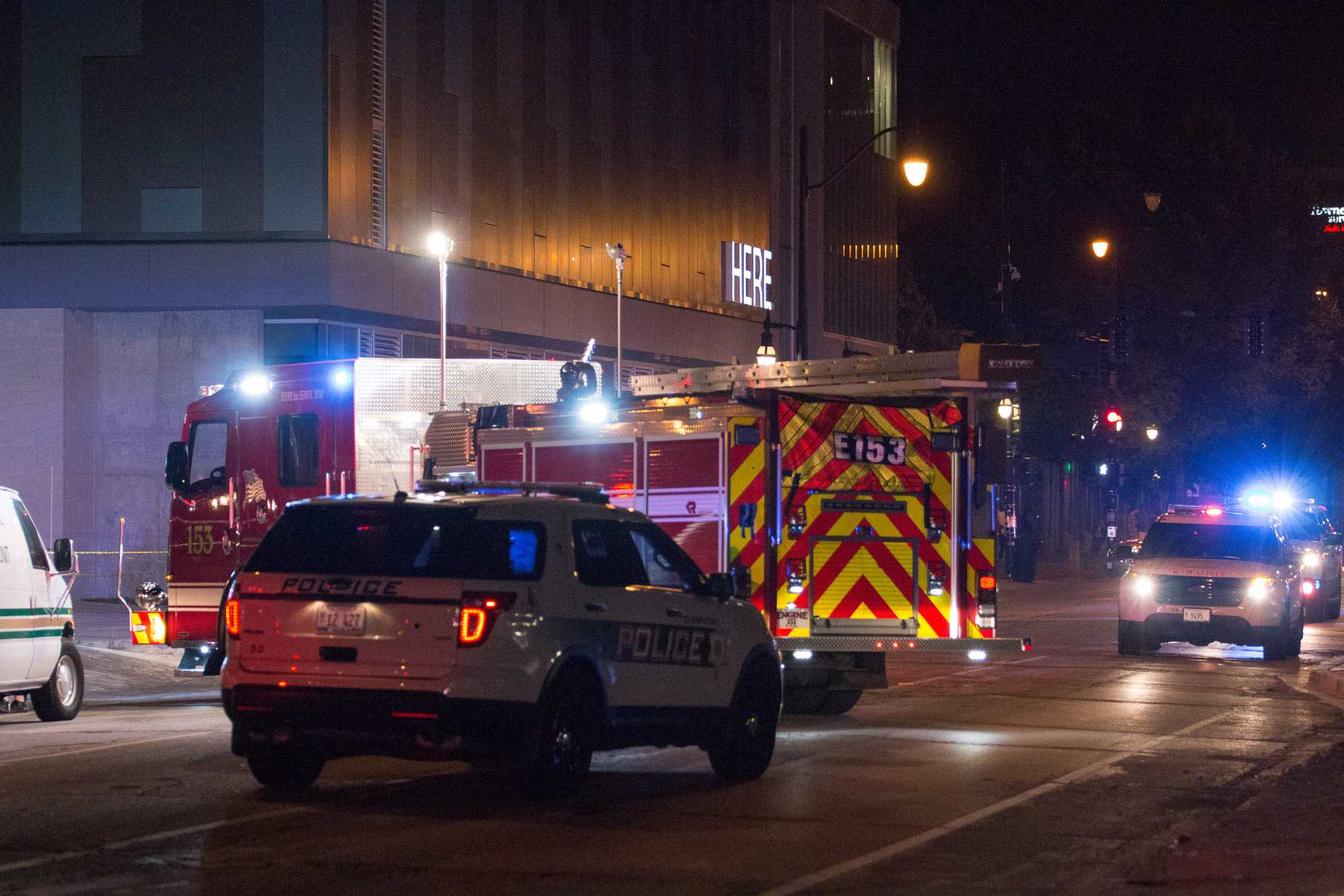 Police cars and a fire truck are parked outside the Here apartment building in the 300 block of Green Street after a shooting that took place early Sunday morning.