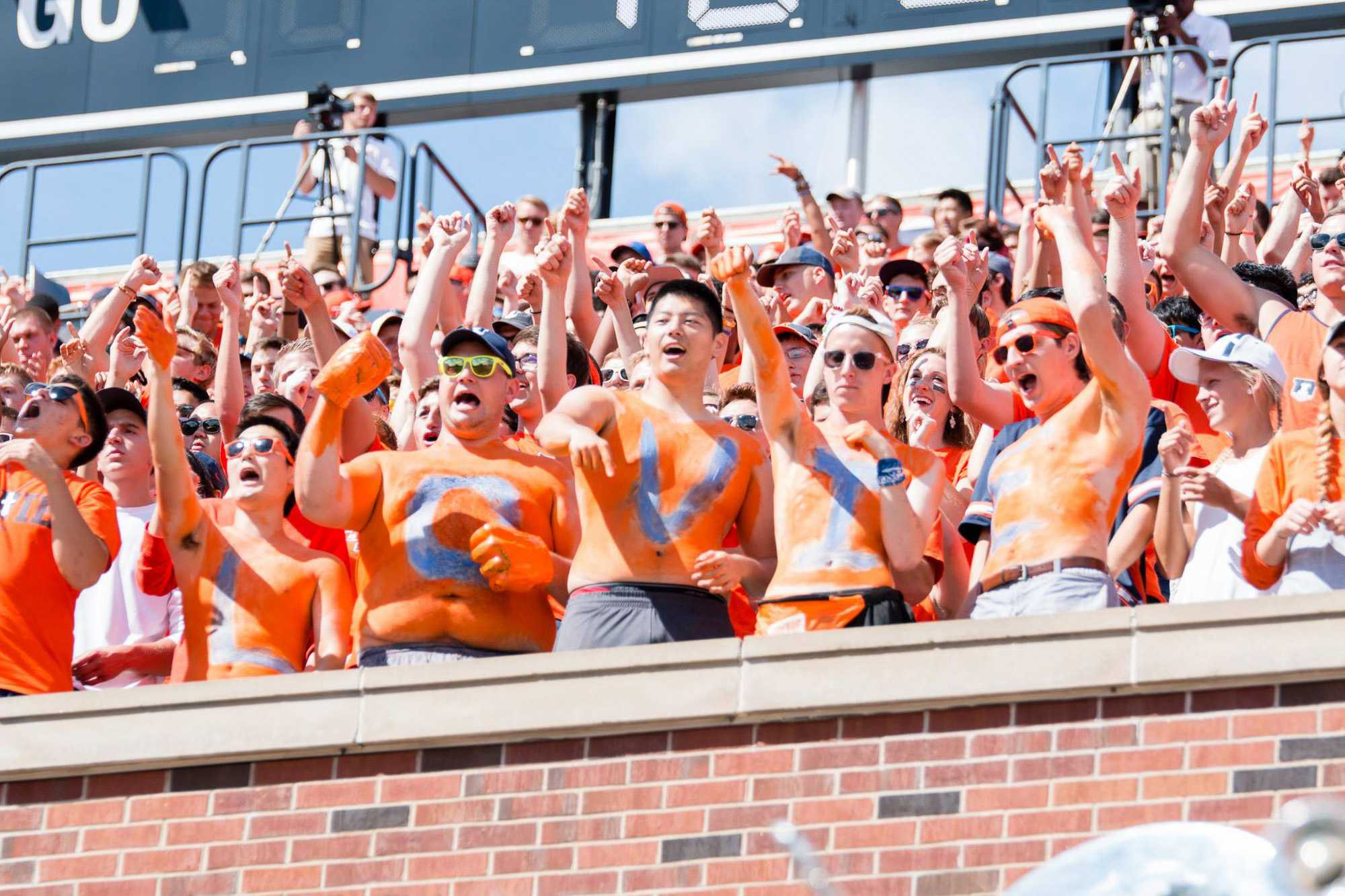 Students wear body paint spelling out Lovie's name cheer during the football game against Murray State.