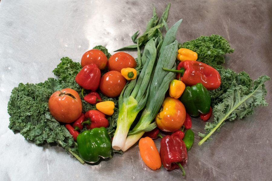 Some of the fresh vegetables that the Newman Cafeteria uses to create healthy meals for students sit on the table on Wednesday, September 14, 2016.