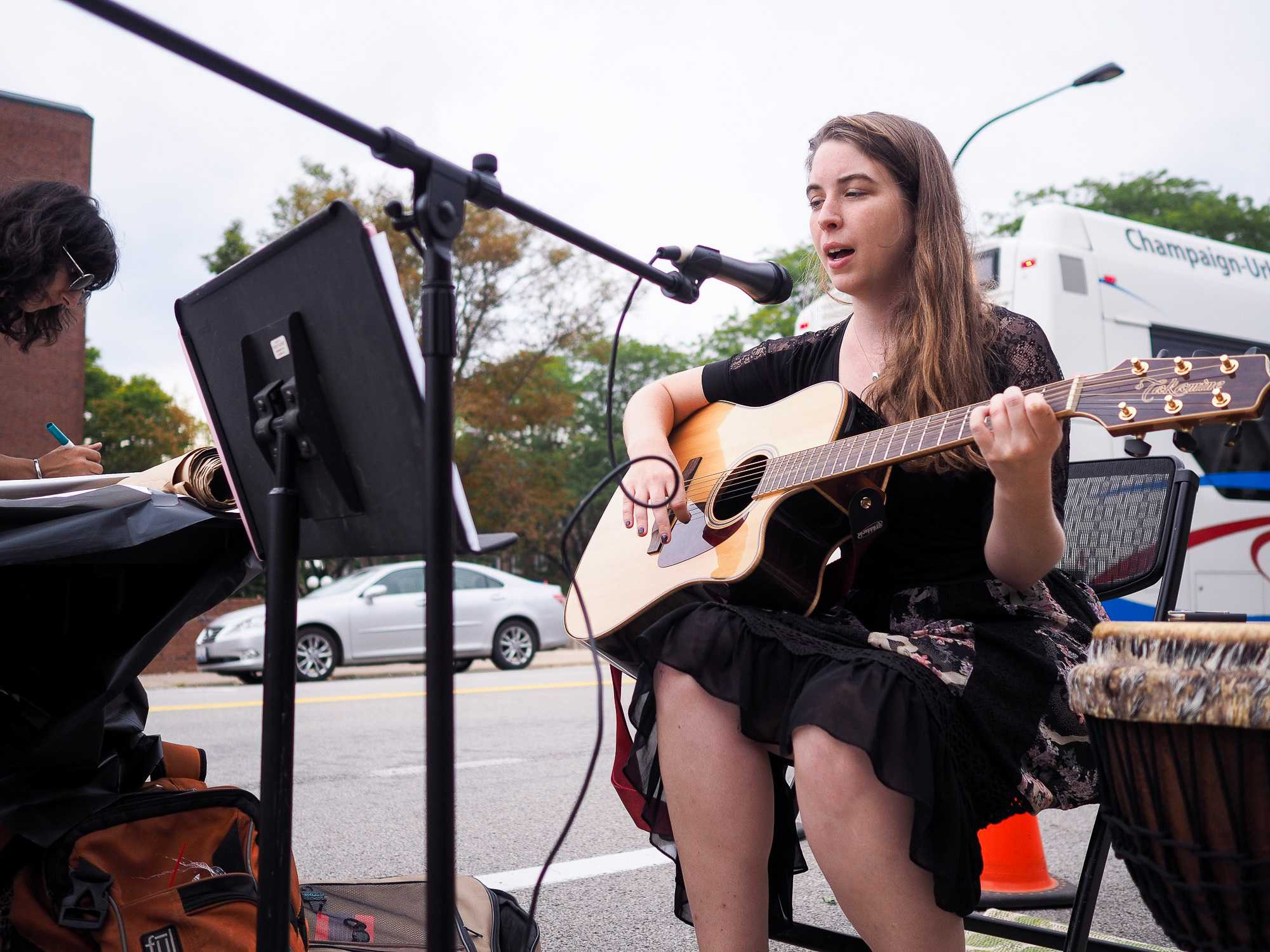 Rachel Wilson, a second year masters student in Urban Planning, performs on Goodwin Avenue for Parking Day in Urbana, IL on September 16, 2016.