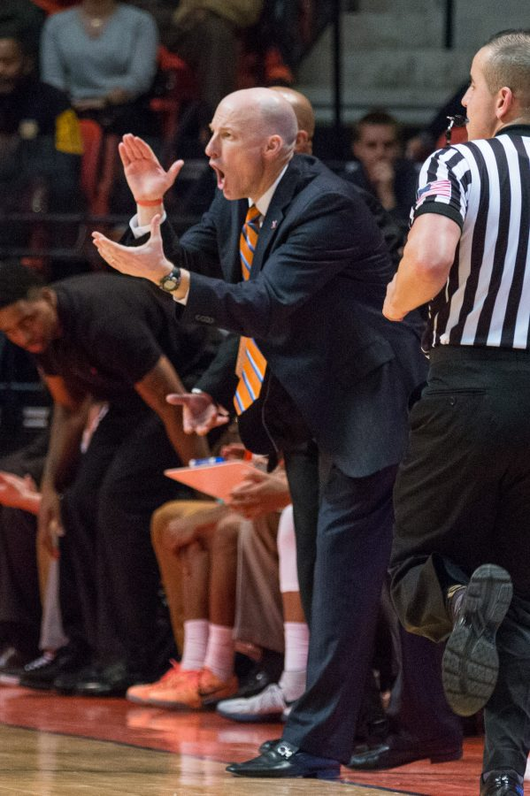 Illinois head coach John Groce shouts instructions to his team from the sidelines during the game against Iowa at the State Farm Center on February 7. The Illini lost 77-65.
