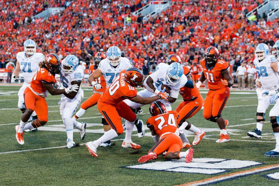 Illinois+linebacker+Hardy+Nickerson+%2810%29+tries+to+strip+the+ball+from+North+Carolina+tailback+Elijah+Hood+%2834%29+during+the+game+against+North+Carolina+at+Memorial+Stadium+on+Saturday%2C+September+10.+The+Illini+loss+48-23.
