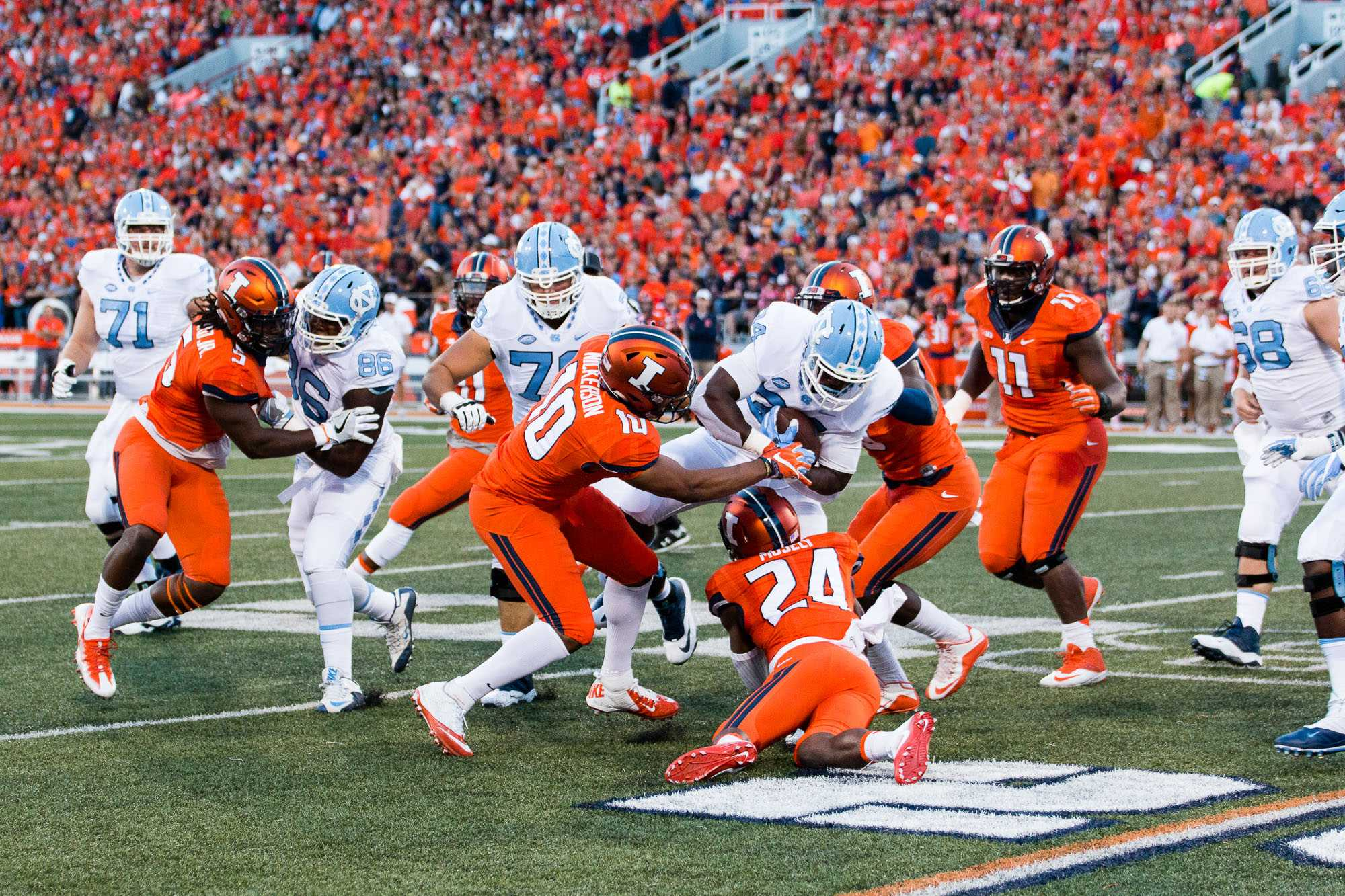 Illinois linebacker Hardy Nickerson (10) tries to strip the ball from North Carolina tailback Elijah Hood (34) during the game against North Carolina at Memorial Stadium on Saturday, September 10. The Illini loss 48-23.