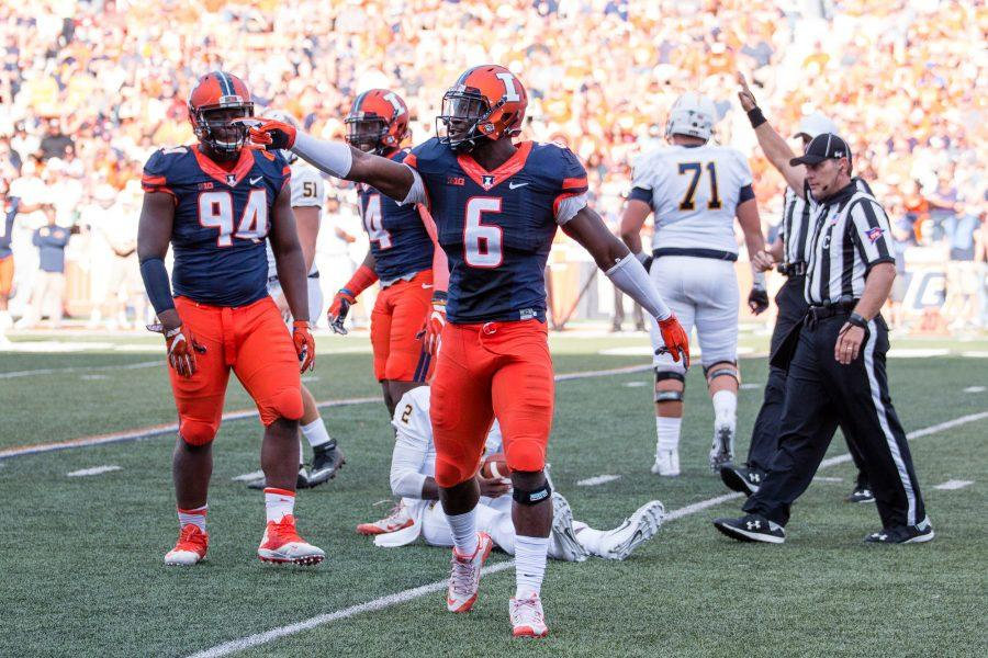 Illinois+defensive+lineman+Carroll+Phillips+%286%29+celebrates+after+sacking+Murrary+State+quarterback+KD+Humphries+%282%29+during+the+game+at+Memorial+Stadium+on+Saturday%2C+September+3.+The+Illini+won+52-3.