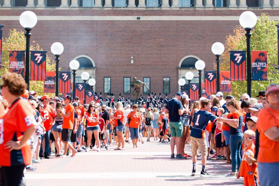 Illinois football fans line the entrance to Grange Grove waiting for the football team to enter before the game against Murray State at Memorial Stadium on Sept. 3.