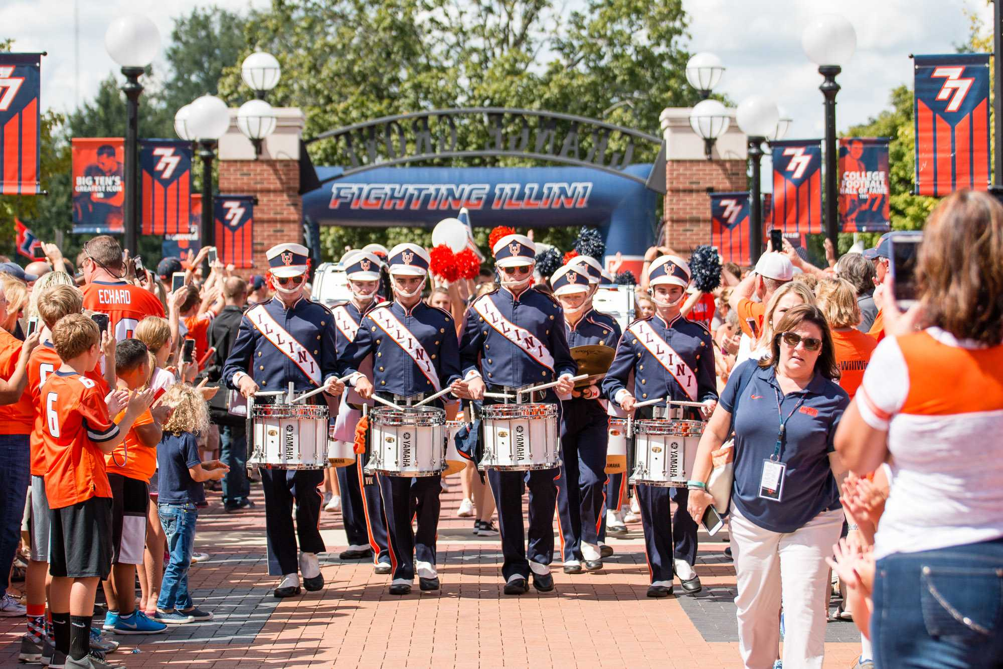 The drum line escorts the football team into Grange Grove before the game against Murray State at Memorial Stadium on Saturday, September 3.