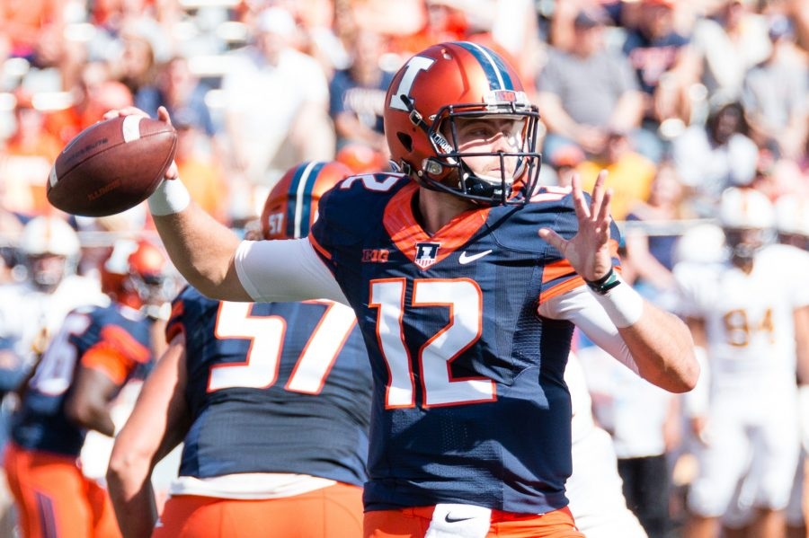 Illinois+quarterback+Wes+Lunt+%2812%29+looks+to+pass+the+ball+during+the+game+against+Murray+State+at+Memorial+Stadium+on+Saturday%2C+September+3.+The+Illini+won+52-3.