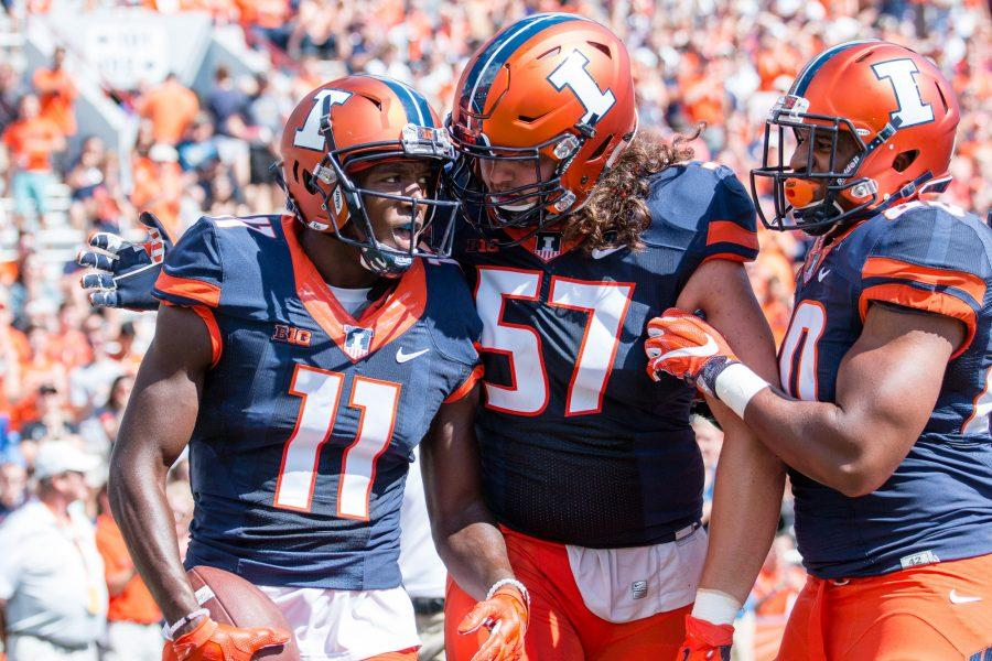 Illinois wide receiver Malik Turner (11) celebrates with offensive lineman Austin Schmidt (57) scoring the first touchdown of the game against Murray State at Memorial Stadium on Saturday, September 3. The Illini won 52-3.