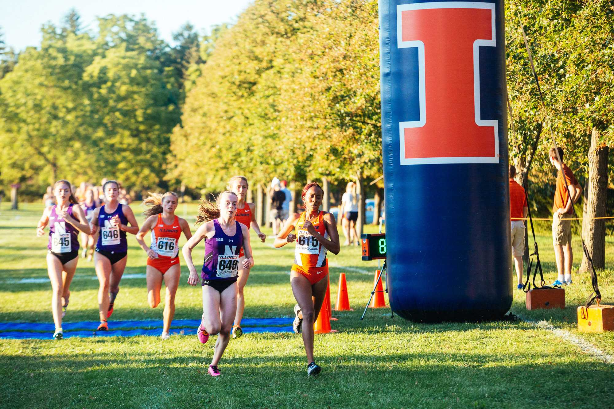 Denise Branch leading the team during the women's cross-coutry Illini Challenge. The challenge was held at the UI Arboretum on Friday, September 2, 2016. As one of the three Fighting Illinis to place in top 10, Denise led the way in fifth place.