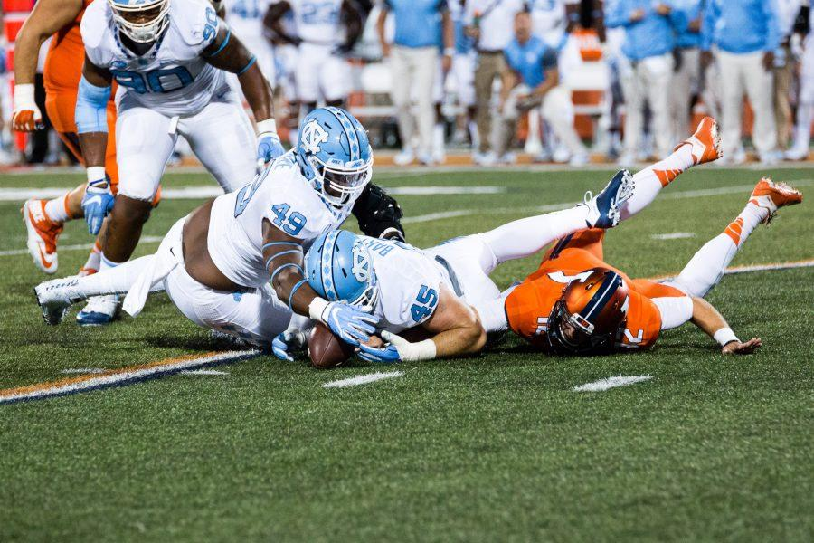 North+Carolina+defensive+end+Mikey+Bart+%2845%29+and+defensive+tackle+Jeremiah+Clarke+%2849%29+dive+on+the+ball+after+Illinois+quarterback+Wes+Lunt+%2812%29+fumbled+during+the+game+against+Illinois+at+Memorial+Stadium+on+Saturday%2C+September+10.+The+Illini+loss+48-23.
