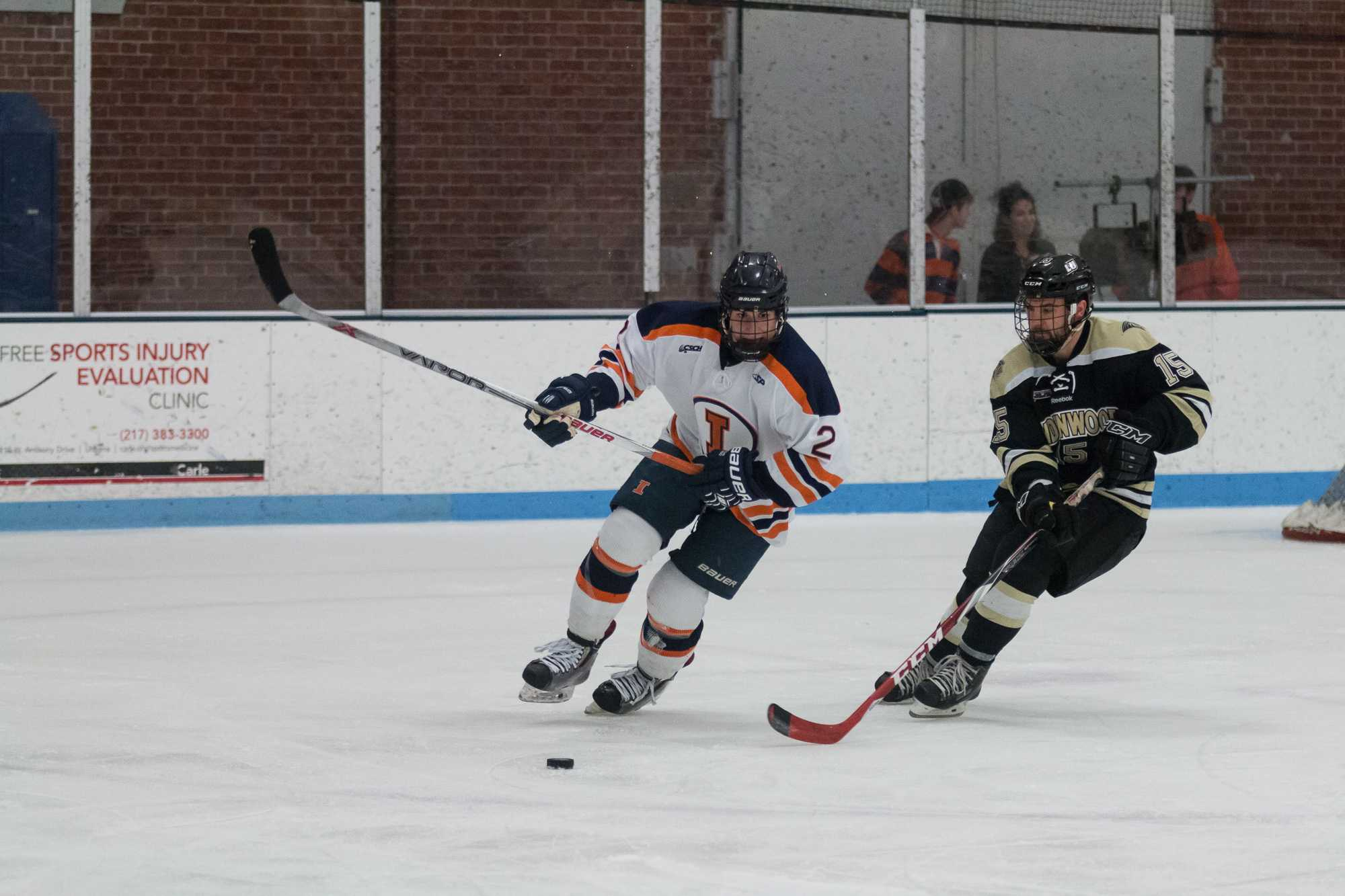 Illinois' Joey Ritondale fights for the puck during the game against Lindenwold University at the Ice Arena on Saturday, January 30. The Illini lost 4-1.