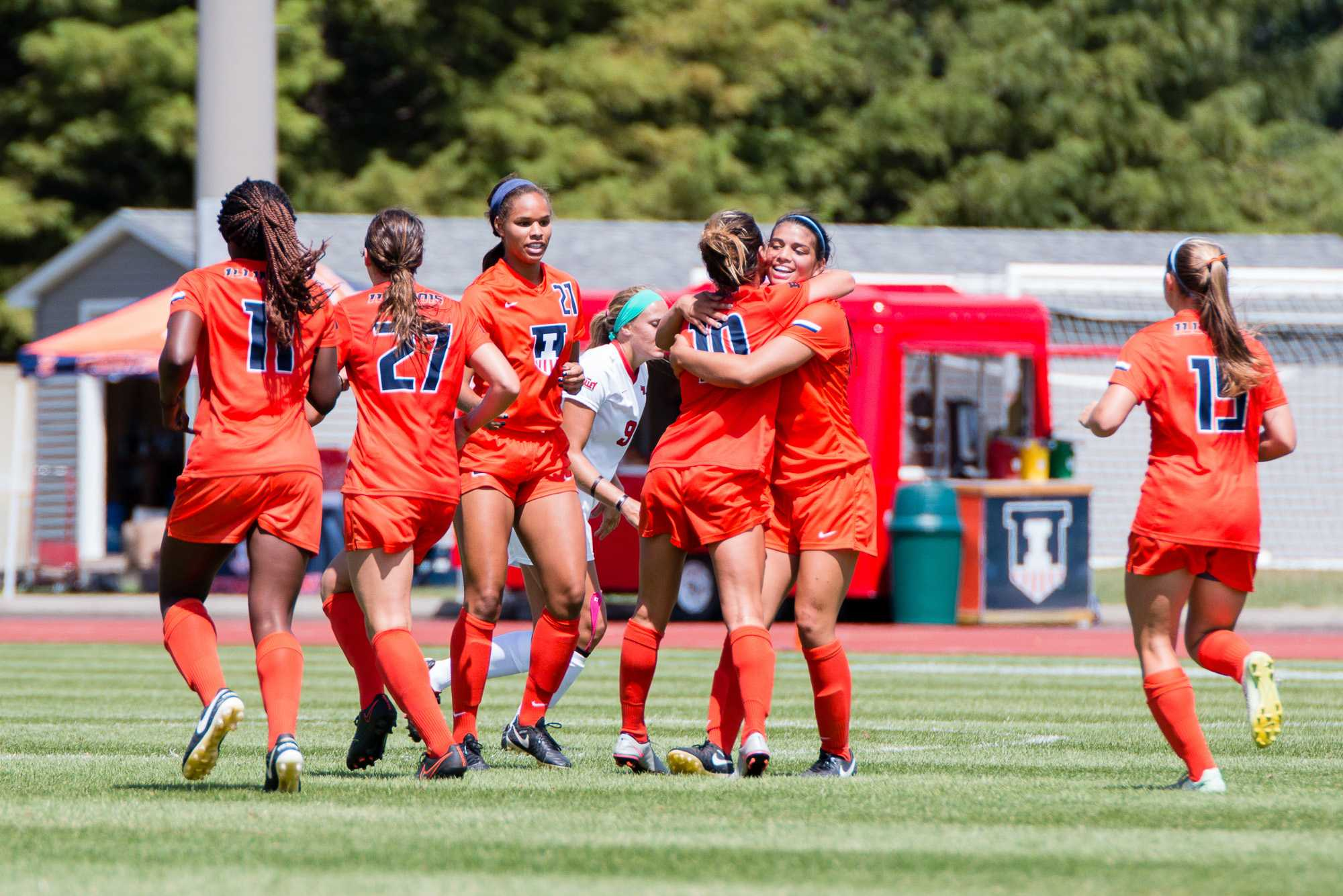 Illinois' Allison Stucky (10) gets a hug from Alicia Barker after scoring the only goal in the game against Illinois State at Illnois Soccer Stadium on Sunday, August 21. The Illini won 1-0.