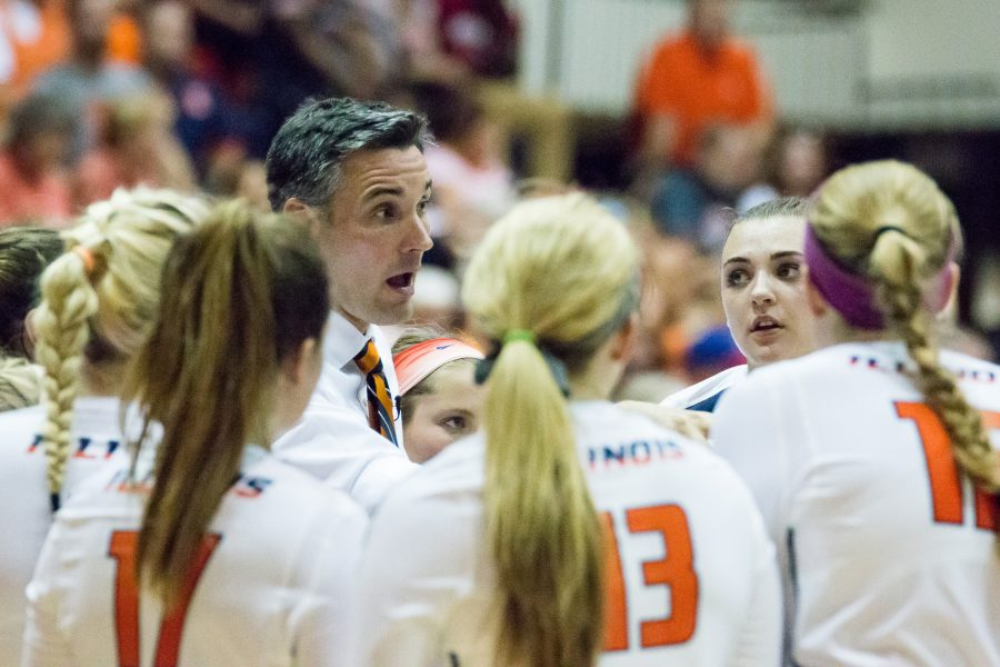 Illinois+head+coach+Kevin+Hambly+talks+to+his+team+between+sets+during+the+match+against+Arkansas+on+August+26.+The+Ilini+won+3-0.
