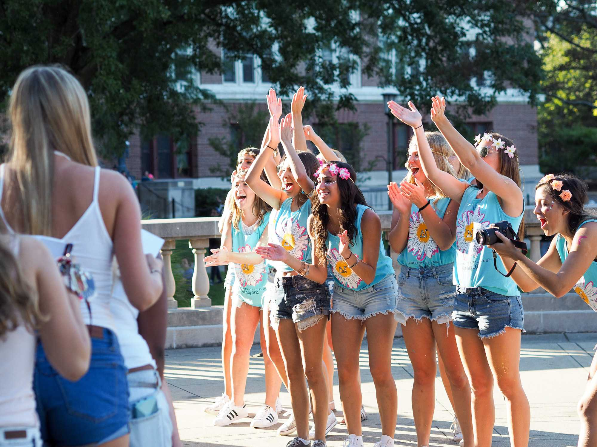 Sorority sisters exit Foellinger Auditorium to join their new sisters on September 12, 2016.
