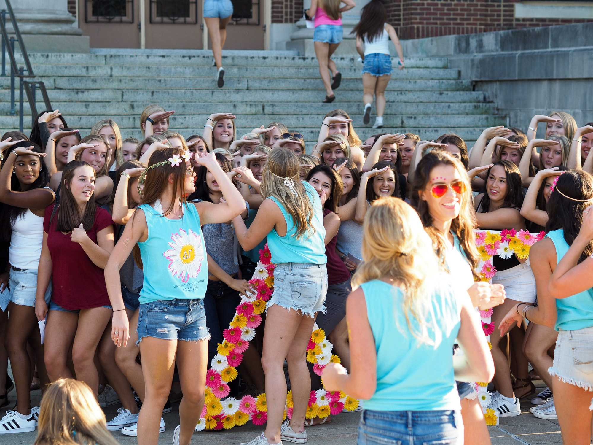 Young women join their new sorority sisters during Bid Day on Monday.