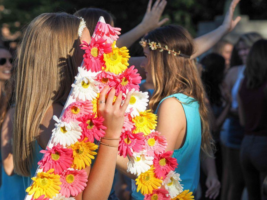 Girls exit Foellinger Auditorium to join their new sisters on Monday, September 12, 2016.