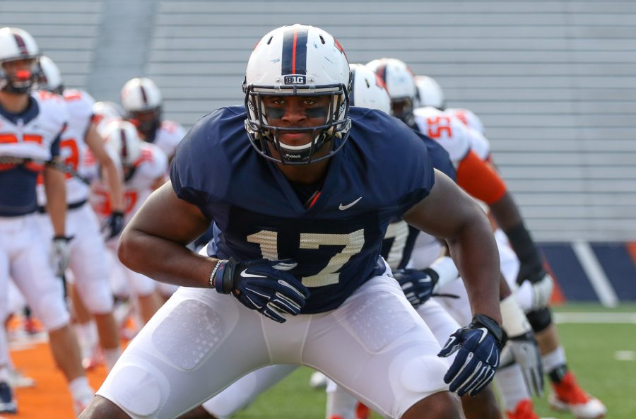 Illinois' Jihad Ward (17) warms up before the annual football Spring Game at Memorial Stadium on Saturday, Apr. 18, 2015. The Orange won 44-41.