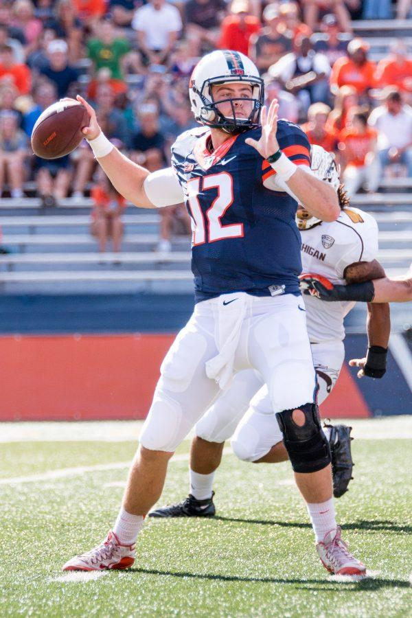 Illinois quarterback Wes Lunt (12) looks to pass the ball during the first half of the game against Western Michigan at Memorial Stadium on Saturday, September 17. The Illini are losing 24-7 at half.