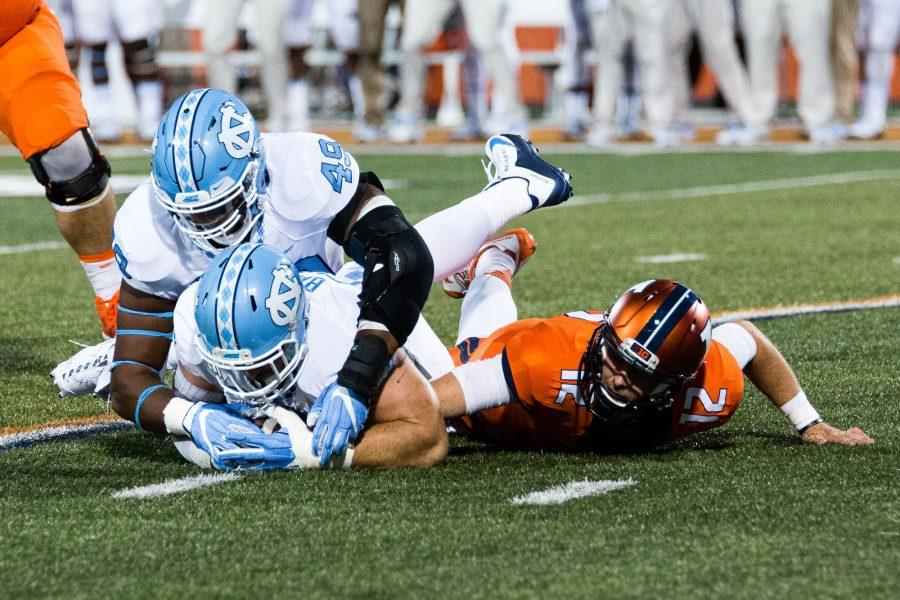 North Carolina defensive end Mikey Bart (45) and defensive tackle Jeremiah Clarke (49) dive on the ball after Illinois quarterback Wes Lunt (12) fumbled during the game against Illinois at Memorial Stadium on Saturday, September 10. The Illini loss 48-23.