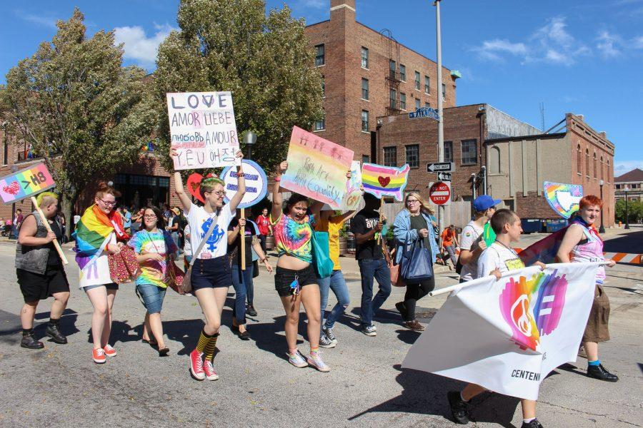 Students+from+Centennial+High+School%27s+Gay-Straight+Alliance+carry+handmade+signs+in+the+C-U+Pride+Parade.