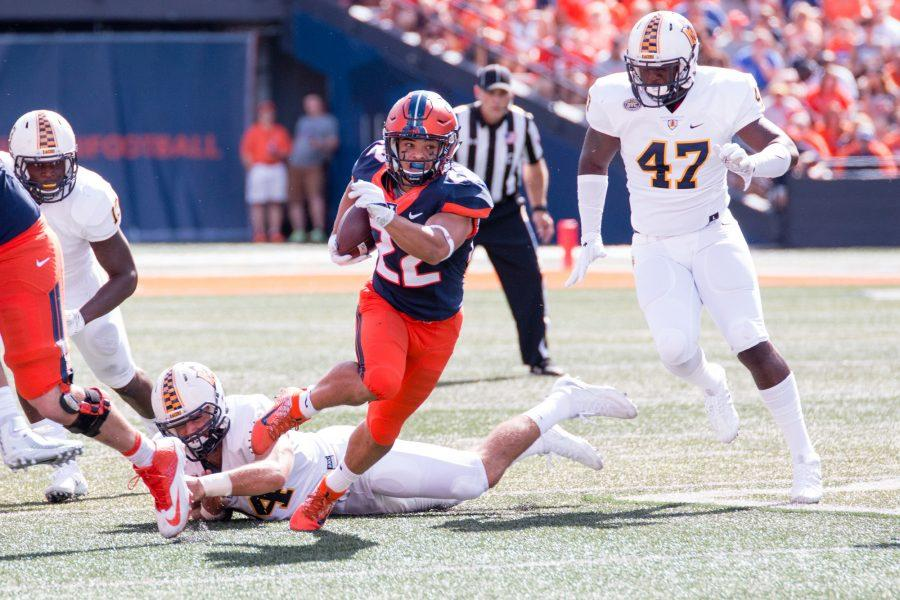 Illinois running back Kendrick Foster (22) runs down the field during the game against Murray State at Memorial Stadium on Saturday, September 3. The Illini won 52-3.