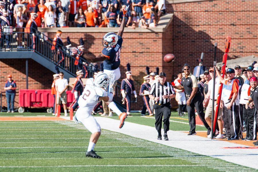 Illinois+wide+receiver+Malik+Turner+%2811%29+misses+a+pass+during+the+first+half+of+the+game+against+Western+Michigan+at+Memorial+Stadium+on+Saturday%2C+September+17.+The+Illini+are+losing+24-7+at+half.