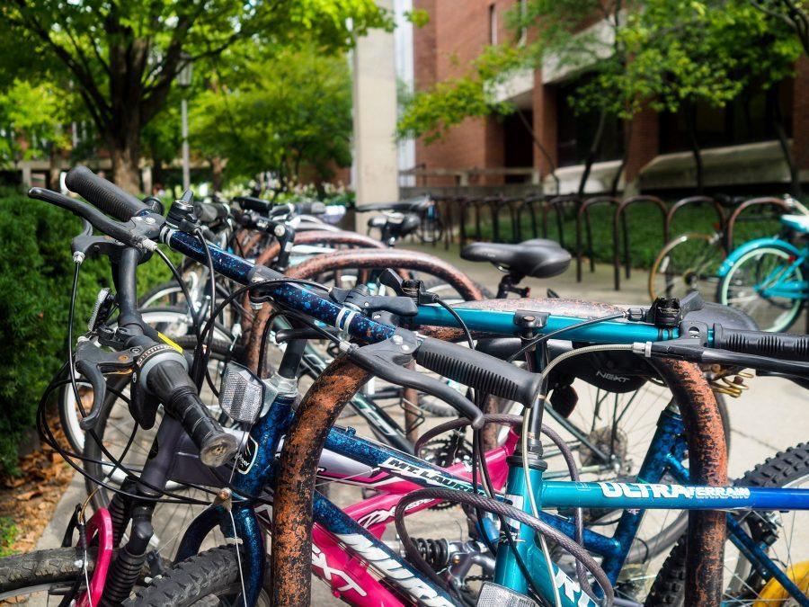 Bikes+sit+at+the+bike+rack+on+the+Quad.