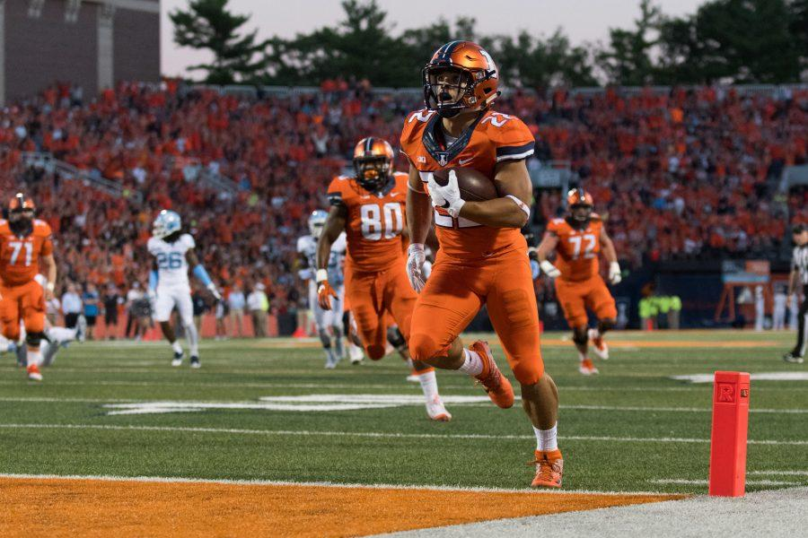 Illinois running back Kendrick Foster scores a touchdown against North Carolina at Memorial Stadium on Sept. 10.