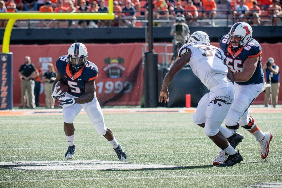 Illinois running back Ke'Shawn Vaughn (5) tries to run the ball down the sideline during the game against Western Michigan at Memorial Stadium on Saturday, September 17. The Illini lost 34-10.