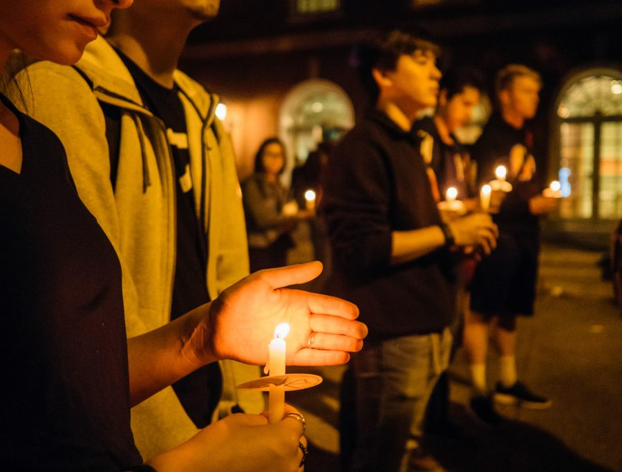 Students light their candles to show their support for the victims of the tragic Sunday shooting during the vigil on Tuesday.