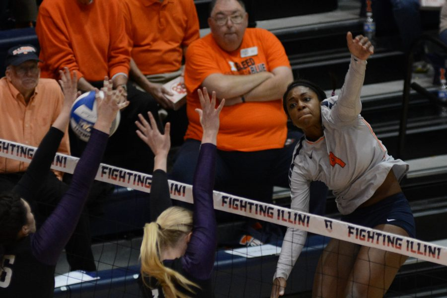Illinois' Naya Crittenden (9) attempts to spike the ball during the match against Northwestern at Huff Hall on Saturday, Nov. 7, 2015. Illinois won 3-1.