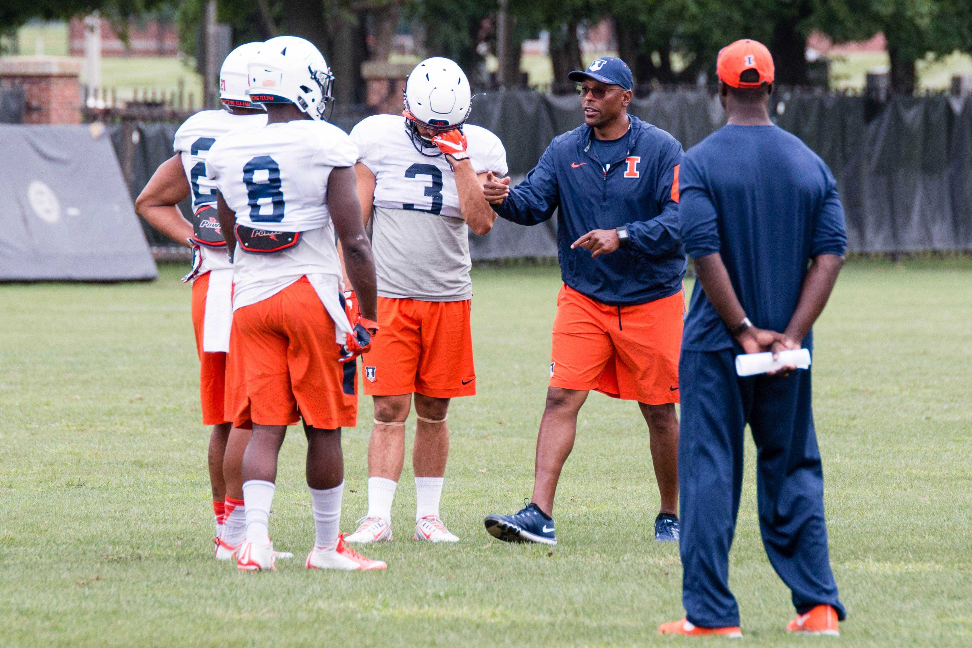 Illinois football defensive coordinator Hardy Nickerson talks to defensive back Dillan Cazley (8) during practice at Memorial Stadium on Wednesday, August 31.