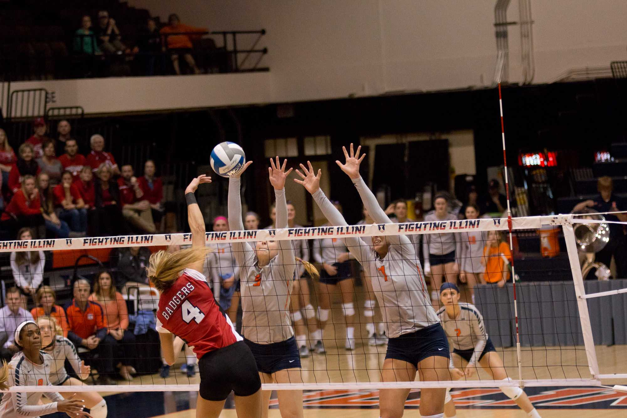 Illinois' Ali Bastianelli and Jocelynn Birks attempt to block a Wisconsin hit during the match against Wisconsin at Huff Hall on Wednesday, Nov. 18, 2015. Illinois lost 3-2.