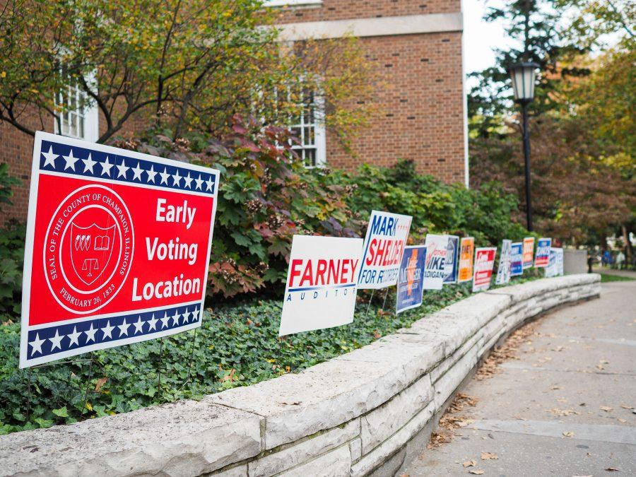 Early+voting+started+at+the+Illini+Union+on+Monday.+Many+campaigns+have+placed+signs+out+front+to+persuade+voters.