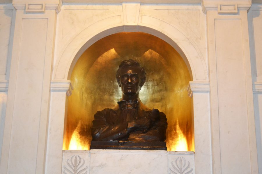 A bust of Lincoln proudly adorns the entrance into Lincoln Hall on the Main Quad.