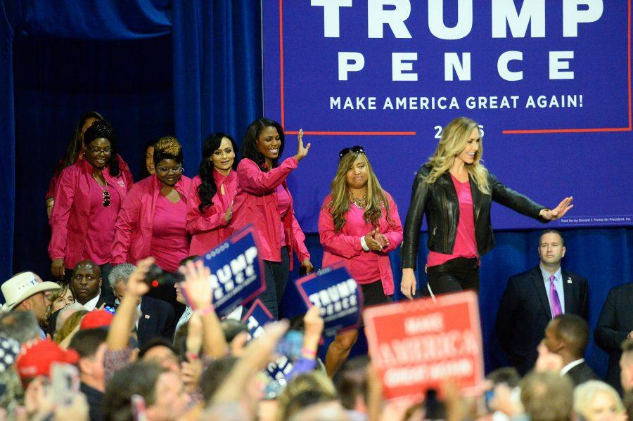 Lara Trump, right, daughter-in-law of Republican presidential candidate Donald Trump, leads members of Women for Trump onstage during a campaign rally at the Charlotte Convention Center in Charlotte, N.C., on Friday, Oct. 14, 2016. (David T. Foster III/Charlotte Observer/TNS)