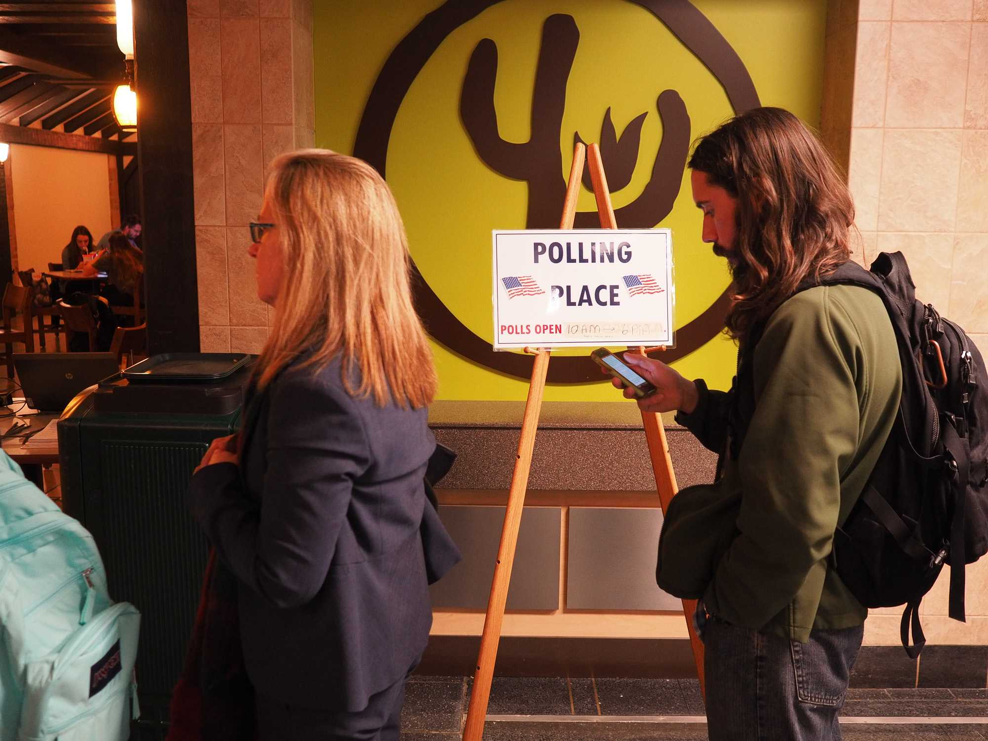Students line up at the polls in the Union basement for early voting.