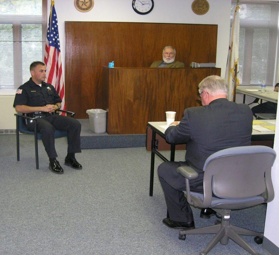 Academy members train during a courtroom scenario.