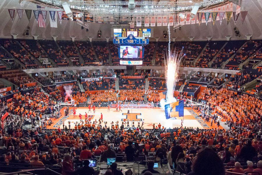 Fireworks+go+off+as+the+Illinois+basketball+team+comes+onto+the+floor+before+the+game+against+Ohio+State+at+the+State+Farm+Center+on+Thursday%2C+January+28.+The+Illini+lost+in+overtime+68-63.