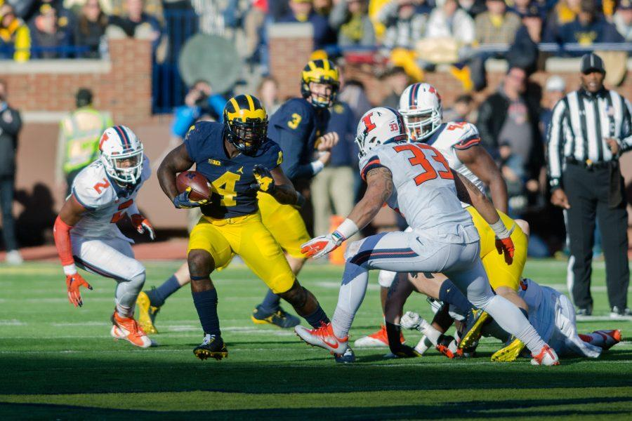 Senior running back De'Veon Smith makes a cut against the Illini defense.